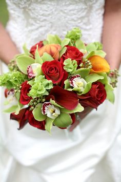 vibrant mix of cymbidums, mango callas & freedom roses www.lilypadfloral.com