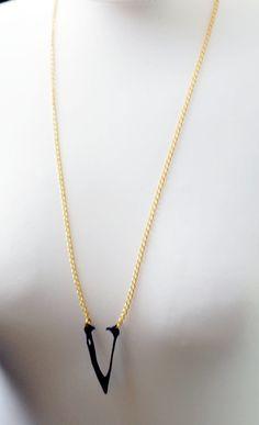 beak necklace