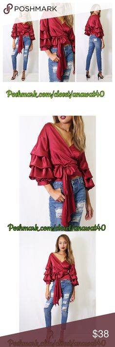 """Ruffle Me Up Top Ruffle Me Up Top  - Surplice neck - 3/4 length puff sleeves - Wrap construction with tie closure - Approx. 20"""" length - Imported Fiber Content:  100% cotton   Fit: this style fits true to size.  Model's stats for sizing: - Height: 5'10.5"""" - Bust: 31"""" - Waist: 22"""" - Hips: 34"""" Model is wearing size S. Tea n Cup Tops"""