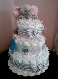 Replace the elephant with a monkey and it's perfect! :) Cuddly elephant diaper cake #DiaperCake #BabyShower #Baby