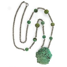 A fabulous vintage Chinese export necklace featuring a double sided carved and pierced green turquoise  flower basket pendant with sterling chain and 10 green turquoise carved Shou beads.  The turquoise is all natural.   The pendant is double sided and  measures 2 1/4  x 2 inches and is  3/16 inches in thickness.  The 10 carved turquoise beads range from 10mm to 14mm.  The necklace has a continuous length of 34 inches.  Total weight 80 grams..