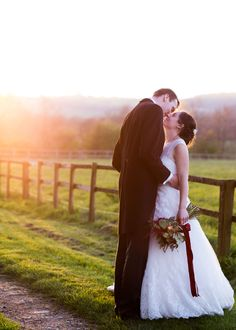 bride and groom about to kiss at sunset outside Bonhams Barn by Jenny Owens Photography