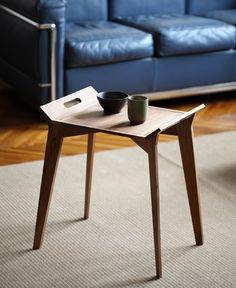 Tanz side table that is also a stool, that is also-- get this-- a tray and stand. Super nice. From Grupa.