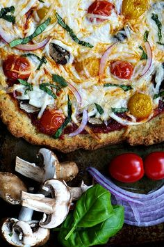 A crispy gluten-free crust with fresh vegetable toppings, including herbed quinoa.