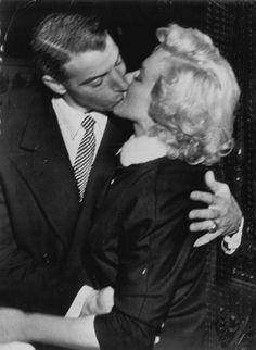 Marilyn Monroe and Joe Dimaggio on their their wedding day.
