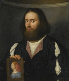 Giovanni de' Busi, called Cariani SAN GIOVANNI BIANCO CIRCA 1485 - 1547 VENICE PORTRAIT OF A GENTLEMAN, HALF LENGTH, HOLDING A PORTRAIT OF A LADY