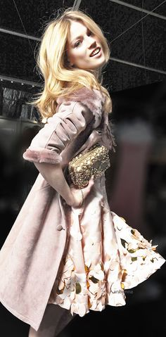 Blumarine.   I love it!!!!!   I want to make sure this is fake fur :)