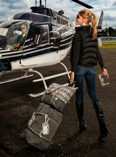 casual traveller - boarding my private helicopter.  The only way to fly!