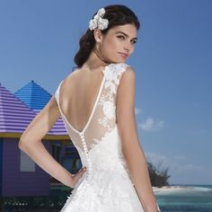 026bdd8fad0842 Tulle A-line with cotton lace features an illusion Sabrina neckline  accented by satin trim with lace drop waist line. Gown has a V- illusion  back and is ...
