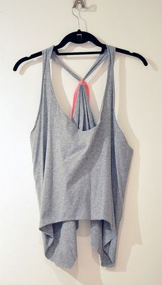 DIY Cut Tank: did this with an my old High School Graduation T-Shirt that was way too big, now its a cute work out tank!