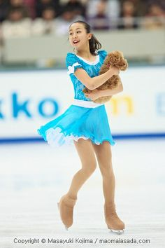 Mao Asada & her dog, Aero, Blue Figure Skating / Ice Skating dress inspiration for Sk8 Gr8 Designs.