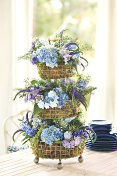 How To make a floral arrangement in wired baskets | with Pin-It-Button on http://www.howtodecorate.com/2013/08/how-to-create-a-tiered-floral-arrangement/