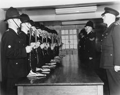 Southampton Police: inspection of police constables' truncheons and handcuffs by Inspector Joe Skelton (on right)