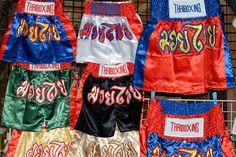 Traditional Thai boxing shorts displayed at a shop