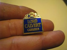 Lord Calvert Canadian Whiskey pin   NEW Blue