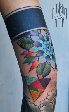 Floral and geometric tattoo.