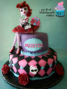 Operetta is the doll the pink and black is like checkers and it has roses and skulls last but not least a name