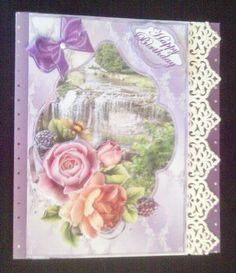 English roses and waterfall on Craftsuprint designed by Carol Dunne - made by SYLVIA Chapman -  I assembled the card using DST and small sticky pads throughout. The picture was printed onto best glossy greeting card and mounted onto a ready made purchased card blank. I glued a strip of toning card to the inside right hand side to show through the lace work, a matching narrower one on the opposite side then cut and shaped my flowers, One tiny pearl on the bow completed the card, and selected…