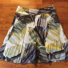 New York and Company skirt size 6 Green, brown, and white patterned skirt with small pleats, creating a flowing silhouette. Like new condition. New York & Company Skirts A-Line or Full