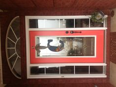 Newly painted front door with new door hanging!