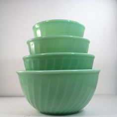This collectible Fire King jadeite swirl mixing bowl set is marked Fire King Oven Ware on the bottom of the bowl. A gorgeous mixing bowl set, that