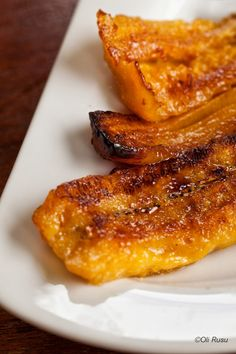 Finger-Lickin' Good Plantain  1 large plantain   1 T butter   2 T brown sugar   Slice plantain in 2 and put in pan over butter. Sprinkle with brown sugar. Bake 450 for 15 min on 1 side, 10 min on other. When is caramelized and look right, is done. Be careful; very soft; sticks on fingers.   Plantain need to be very well ripe. Just yellow looking not enough. Need some dark spots on it, than is good.