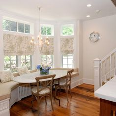 Airy pattern on roman shades hung below transom to let in light more