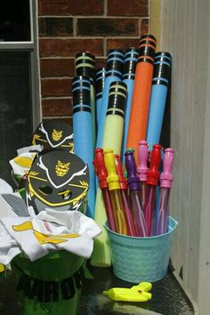 """Power Rangers Birthday Party! Cut pool noodles and wrap with black tape for harmless """"swords"""""""