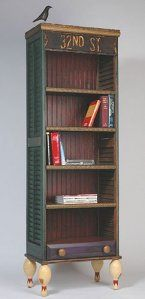 Turn shutters into a bookshelf- love the street sign used at the top for molding!