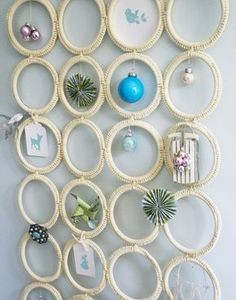 This modern take on a shadow box creates a yuletide memory display of mini ornaments and holiday ephemera.  (uses a scarf holder from IKEA)  ////   could display photos or any small items