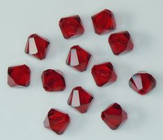 Swarovski 5301 / 5328 8mm Siam Red Bicone Beads  by BestBuyDesigns