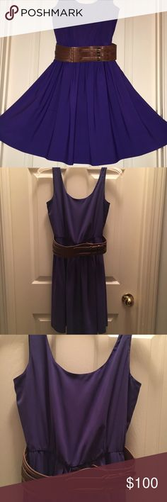"""{ Calvin Klein } vintage indigo belted dress Beautiful vintage Calvin Klein dress in excellent condition! Side 2 Petite. Worn once and dry cleaned. Color is indigo - dark purple, looks blue in some lighting. Dress is accented by a thick brown belt. Flat measurements: approx 15"""" bust, 12"""" at cinched waist, 34"""" from top of shoulder to hem. Calvin Klein Dresses Midi"""
