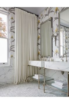 """[i]In a bathroom, [link url=""""http://www.cole-and-son.com/en/""""]Cole & Son[/link] 'Orchid' wallpaper softens the effect of the marble basins and grey mosaic flooring.[/i]  Like this? Then you'll love  [link url=""""http://www.houseandgarden.co.uk/interiors/bathroom-wallpaper""""]Bathroom Wallpaper[/link]"""