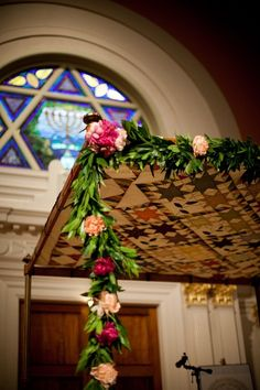 Chuppah. garlands on all four posts would be ideal, they would dress up the plain posts and still make it reasonable for people to transport.