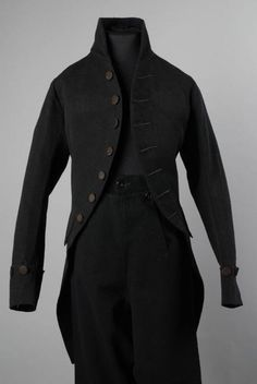 Boy's formal coat and breeches, 1780-1790. Black wool plain weave, black silk covered buttons.