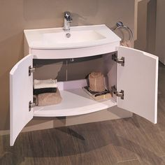 The Voss™ 620 wall mounted vanity basin unit. A beautifully crafted bow front vanity unit with matching inset basin. Behind the soft close double doors there is plenty of storage and the stylish design makes this vanity unit the perfect choice. Also ava Basin Vanity Unit, Basin Unit, Vanity Units, Bathroom Sets, Vanity Bathroom, Storage Drawers, Storage Units, Inset Basin, Wall Mounted Vanity
