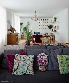 open living room with gray couch and colorful pillows