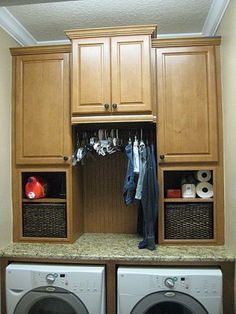 Laundry room idea Good idea for a rod for hanging clothes.  Cupboard and counter colors