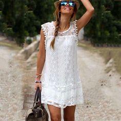Ucuz 2015 yeni moda kadınlar beyaz dantel mini elbise casual o boyun kolsuz patchwork püskül elbiseler vestidos de renda artı boyutu, Satın Kalite elbiseler doğrudan Çin Tedarikçilerden:  2015 Sexy Summer Style Lace Dress Patchwork and Sleeveless Striped Printing Dress Women's Beach Sexy Casual Party