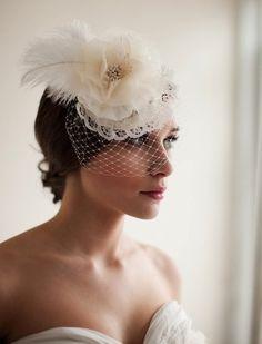 This Melinda Rose Design bridal mini hat veil ($175) emotes a sweet, throwback vibe for the art-deco bride.