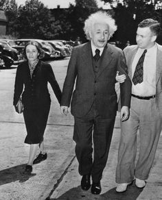 """Professor Albert J. Einstein, exiled German mathematician and author of the intricate theory of relativity, is accompanied by his daughter, Margaret, and a reporter as he goes to the Federal Building here, to take his final examination before becoming a citizen of the United States. His daughter also seeks citizenship. """"Sure, who wouldn't be,"""" the noted scientist replied when asked if he was happy at the prospect of becoming a U.S. citizen. He will be sworn in next October - if he passes…"""