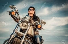 Biker Girl In A Leather Jacket On A Motorcycle Looking At The.. Stock Photo, Picture And Royalty Free Image. Image 28566469.