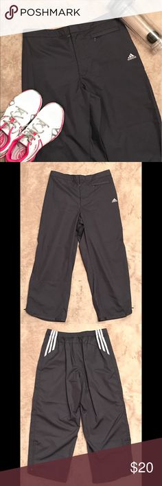 Adidas running pants Grey adidas cropped running pants with pink detail on back. Velcro on zipper. Side zip pocket and zippers on legs. Back elastic band. Great condition. Size medium. Adidas Pants Track Pants & Joggers