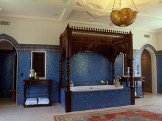 A bedroom is converted into an oversized Moroccan bath fit for a sultan. Every tiny tile was hand cut in Morocco. A canopy tub adds a luxurious touch to this North African- inspired space.
