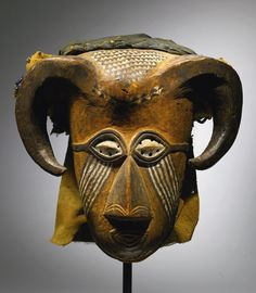 Africa | Mask from the Kuba people of DR Congo | Wood, pigment and textiles