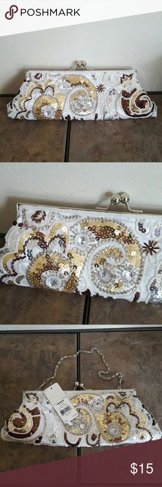 Apt. 9 Evening/ Prom Bag/Clutch NWT Apt. 9 from Kohl's.  Pretty white satin bag embellished with gold, silver, and bronze sequins and beads.  Silver chain to hold as a bag or hide for clutch use.  White satin interior with slip pocket. Apt. 9 Bags Clutches & Wristlets