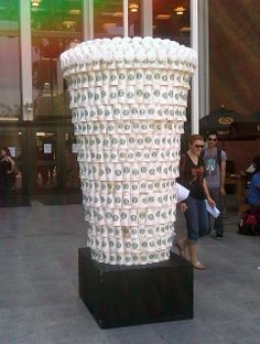 Starbucks cups stacked into a giant Starbucks cup art piece!
