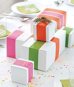 White boxes plus colored tape equals instant wrapping. | Find 24 creative ideas to make your wrapping as special as the gift itself.