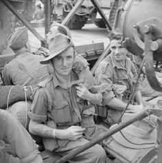 British troops and vehicles on a ferry crossing the Chindwin River between Kalewa and Shwegying Burma January 1945. One soldier has a pet monkey.