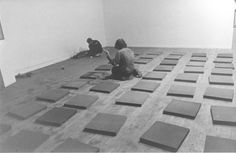 Vito Acconci arranging cushions for PersonA, curated by Edit deAk, April 1974